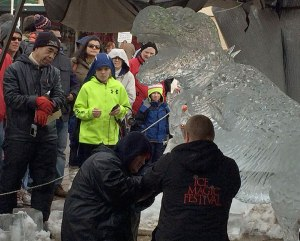 Everybody-Walk-Your-Dinosaur-Ice-Sculpture-working-on-leash
